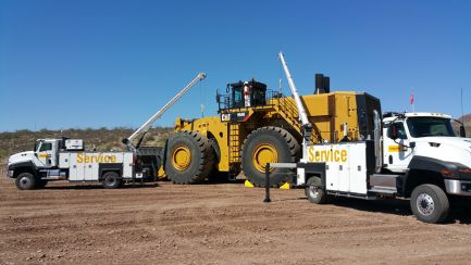 Two_Maintainer_trucks_with_mining_equipment.jpg